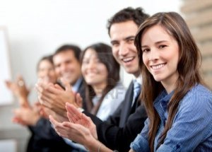 business-team-clapping-a-good-presentation-in-an-office