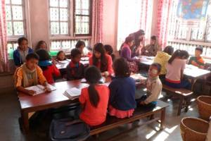 Tuition time for the youngest children; Pratikshya is in the middle and Sarita to the end.